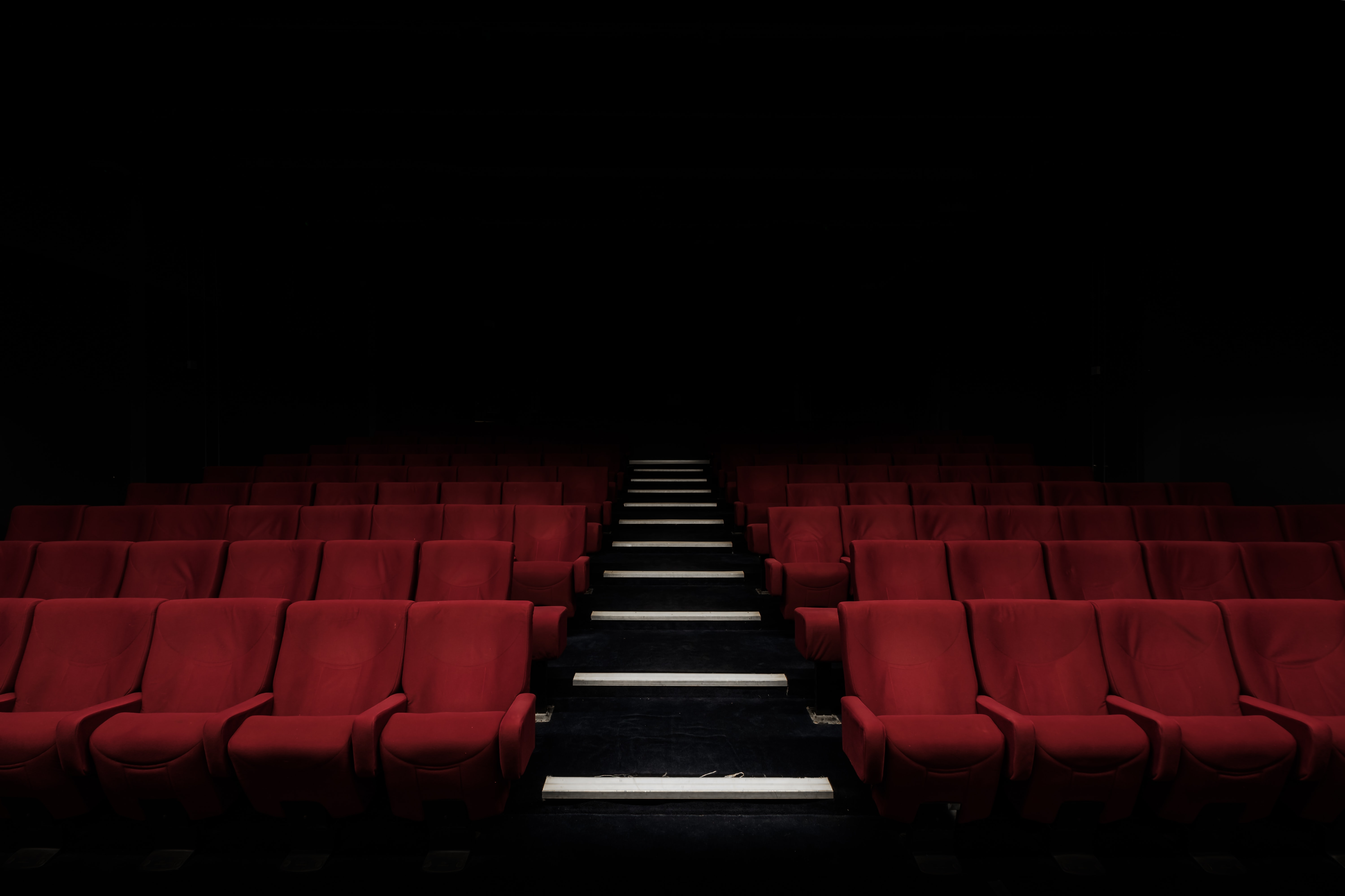 school theater seats red chairs black stairs